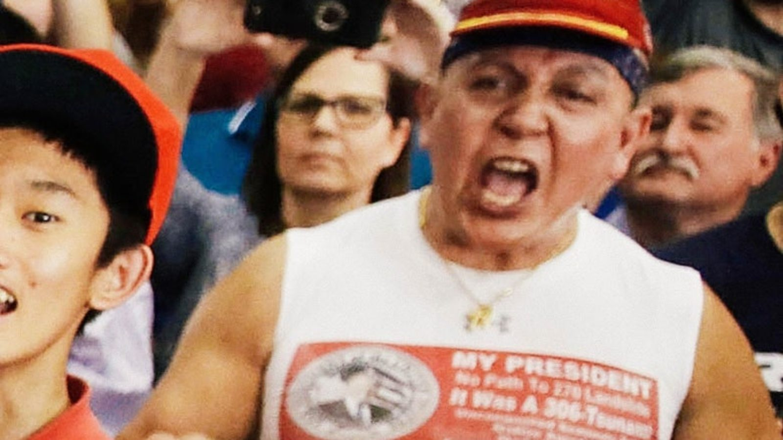 A man shouts at a rally for President Trump