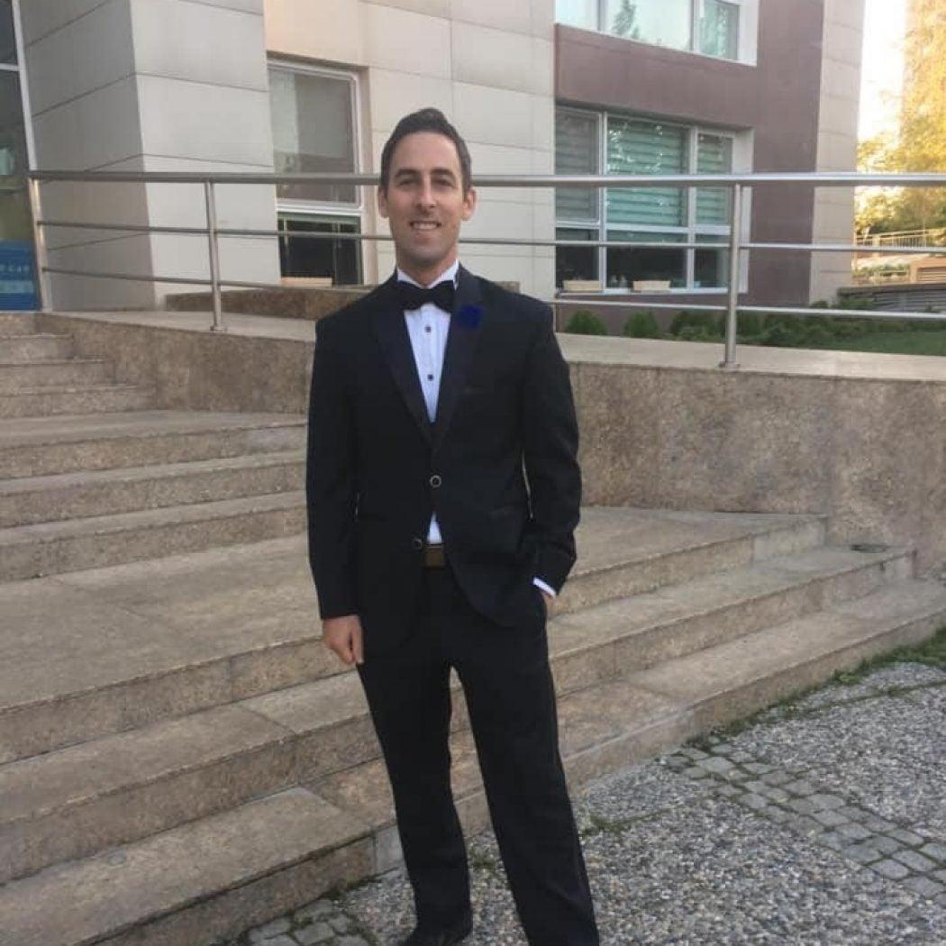 JP Bernard standing in a tuxedo