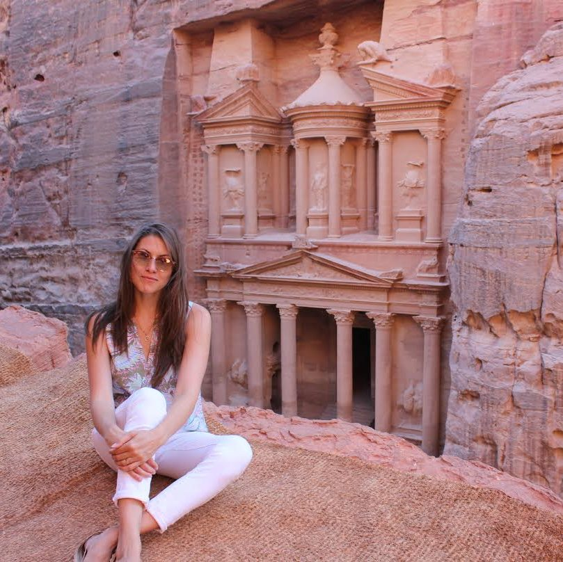 Aliya Mazza in front of carvings at Petra