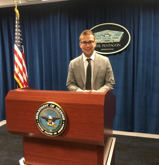 Ari Weifuse at a Department of Defense lectern at the Pentagon