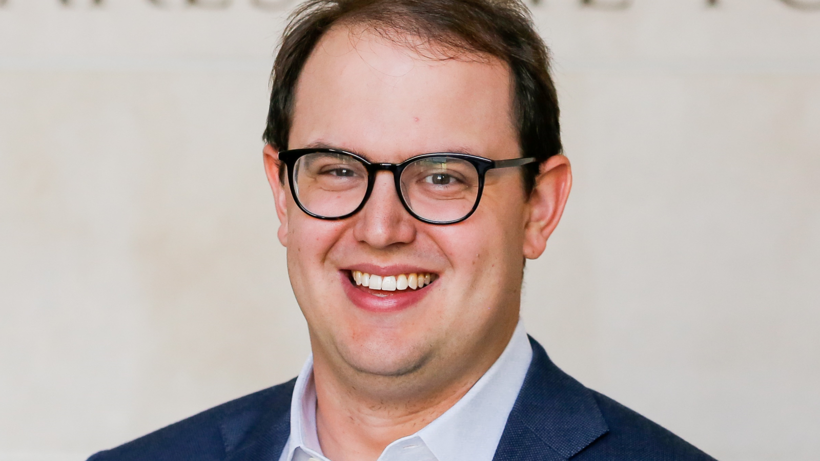 Headshot of Ben Buchanan