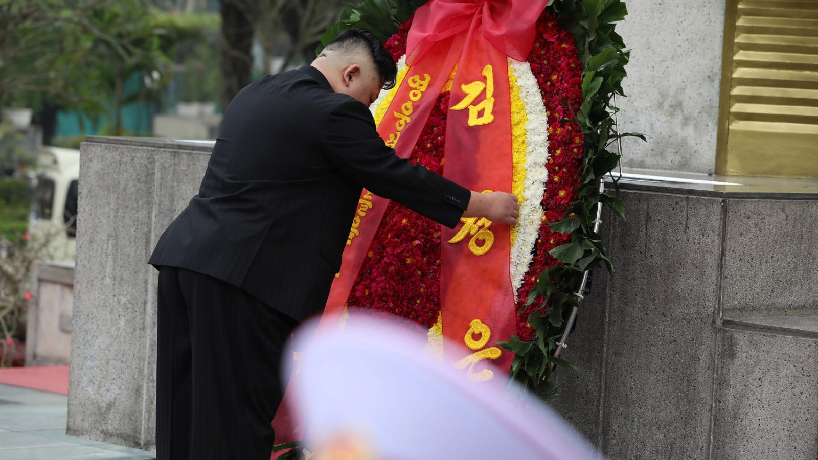 North Korean Leader Kim Jong-un Visits Vietnam and lays a red, white, and yellow wreath in Hanoi