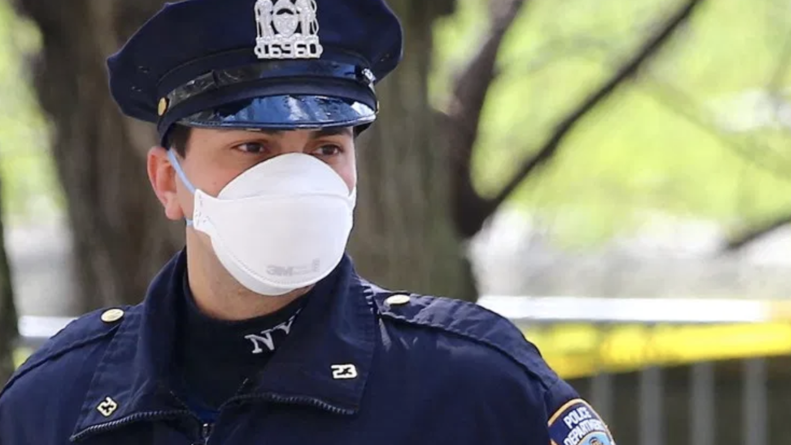 A police officer wears an N95 mask
