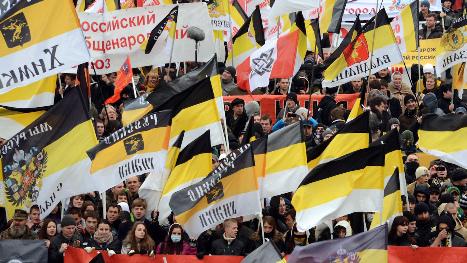 Russian ultra-nationalists wave Russian Empire's black-yellow-white flags as they take part in the so-called