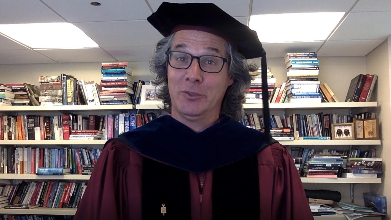 Dr. Keir Lieber, wearing academic regalia and speaking from his office