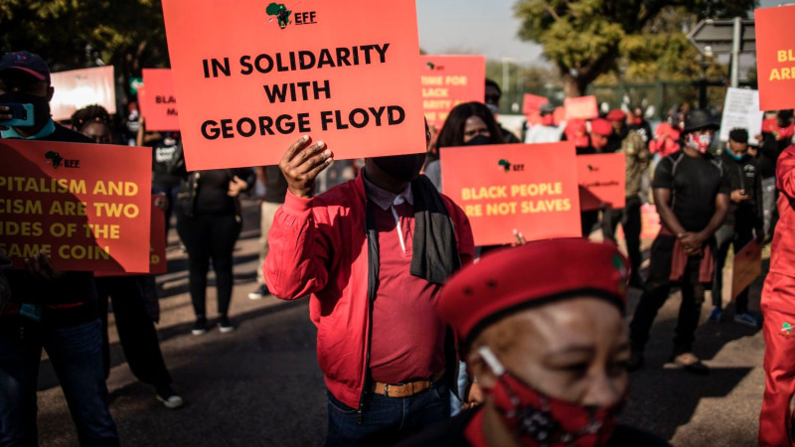Economic Freedom Fighters supporters hold Black Lives Matter signs in front of the U.S. Embassy in Pretoria