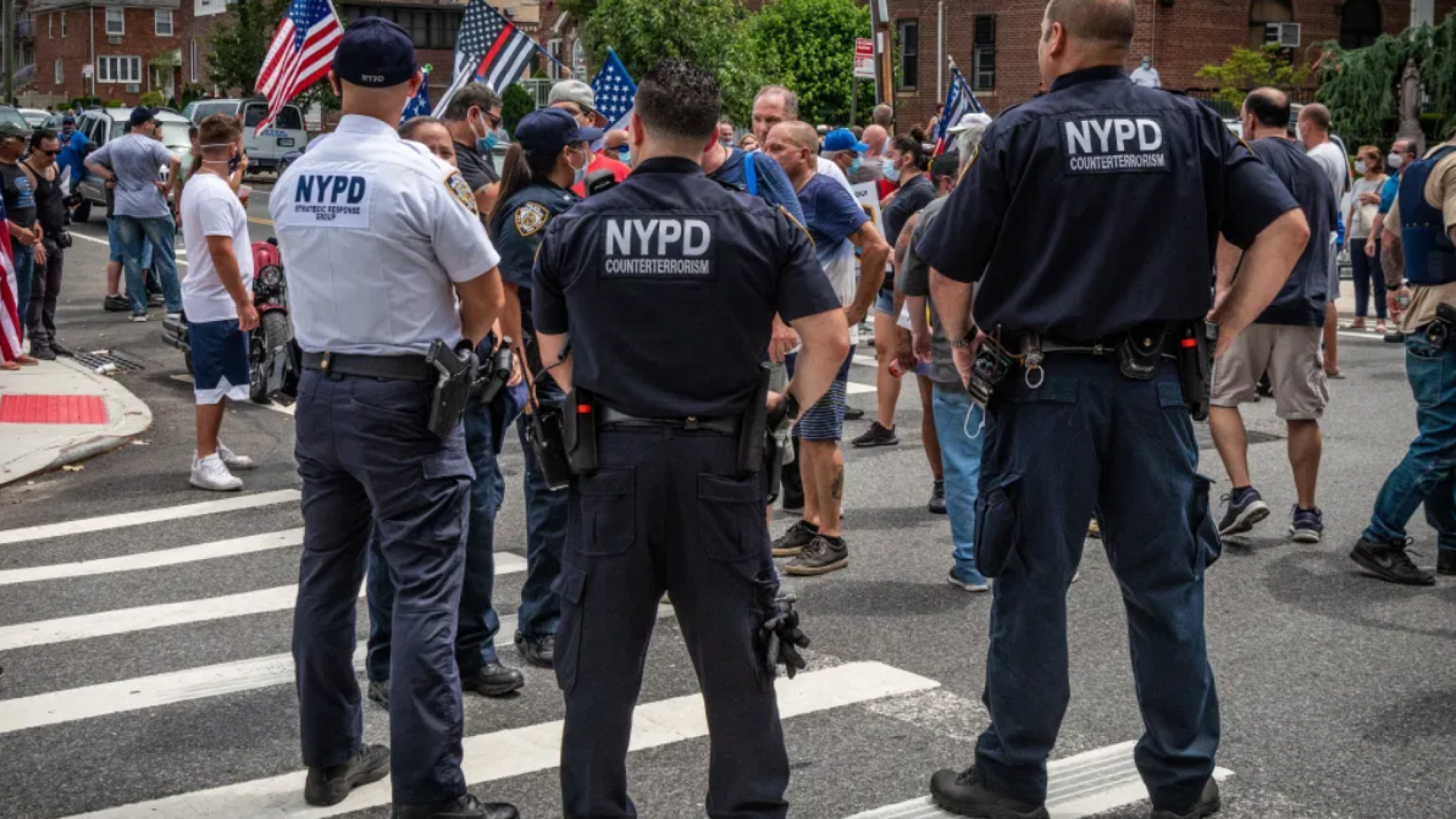 NYPD counterterrorism officers stand in front of a crowd
