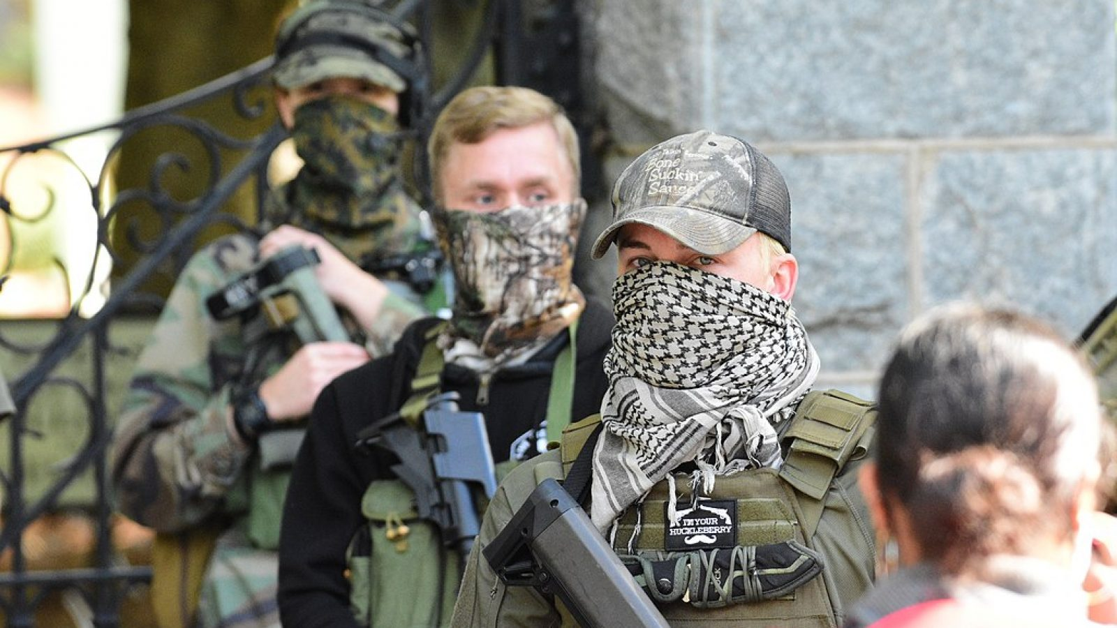 Masked Boogaloo bois attend a rally carrying rifles.
