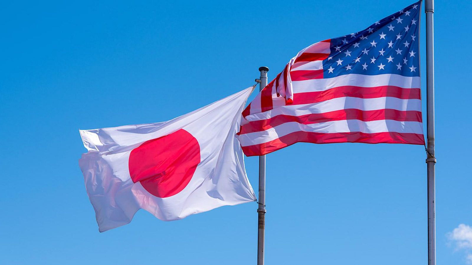 The U.S. and Japanese flags fly side by side.