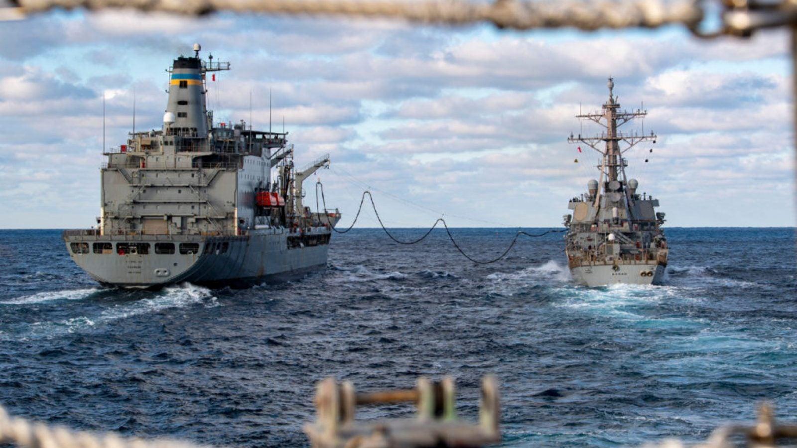 Two large naval ships at sea
