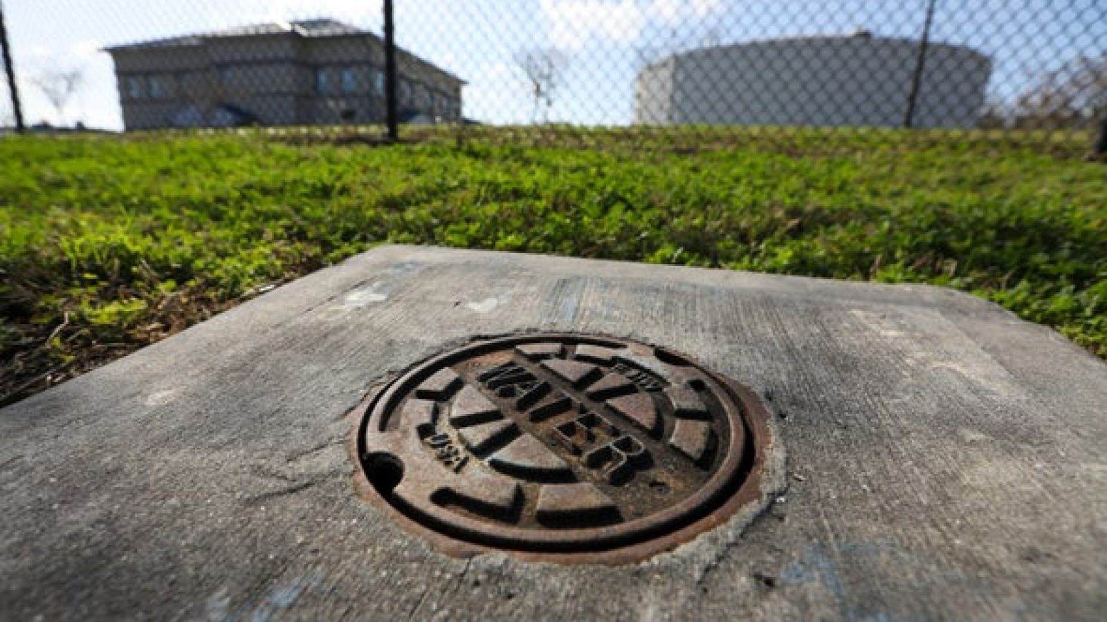 A photo of a manhole that says