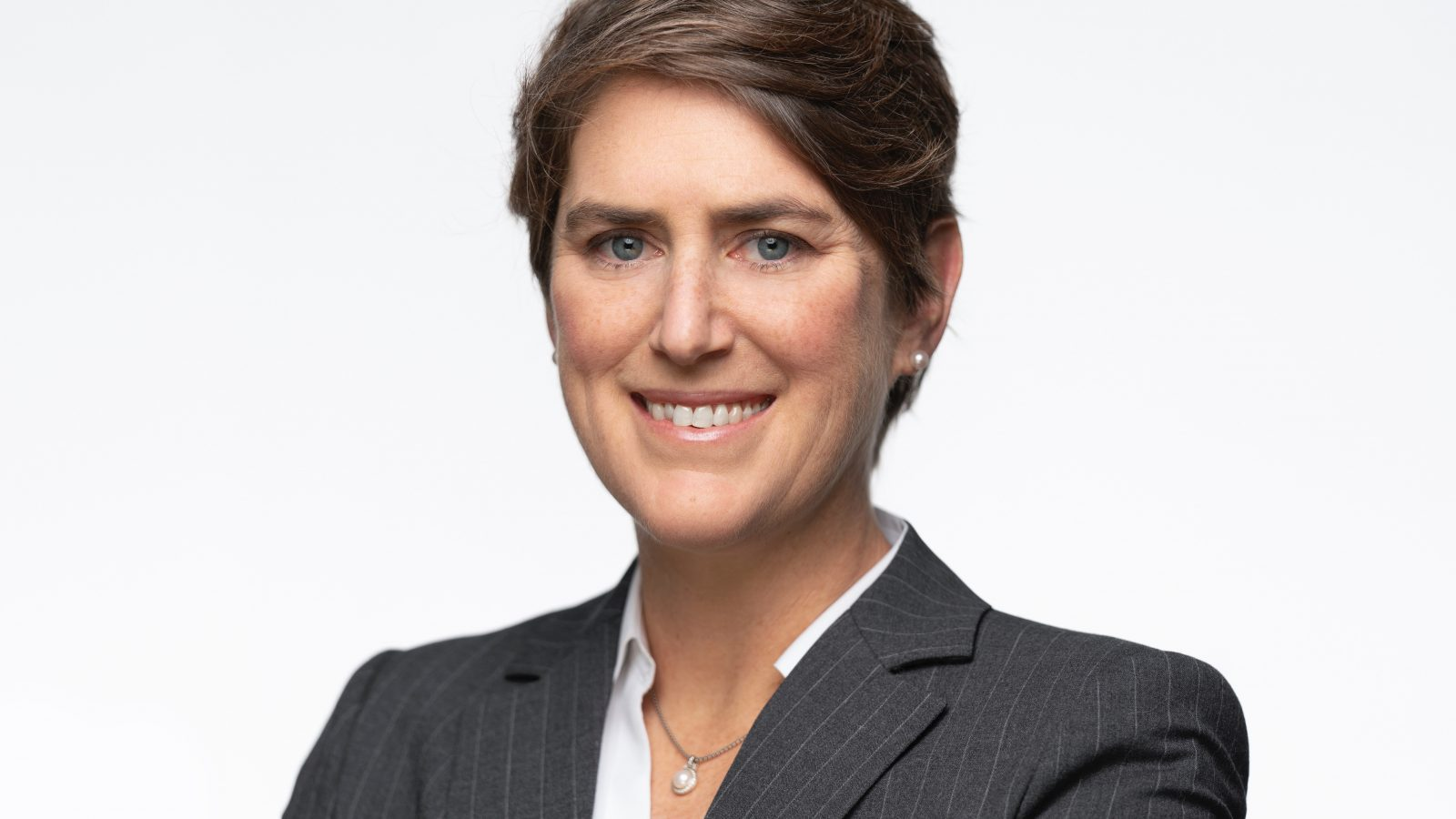 A headshot of Professor Kyleanne Hunter against a white background