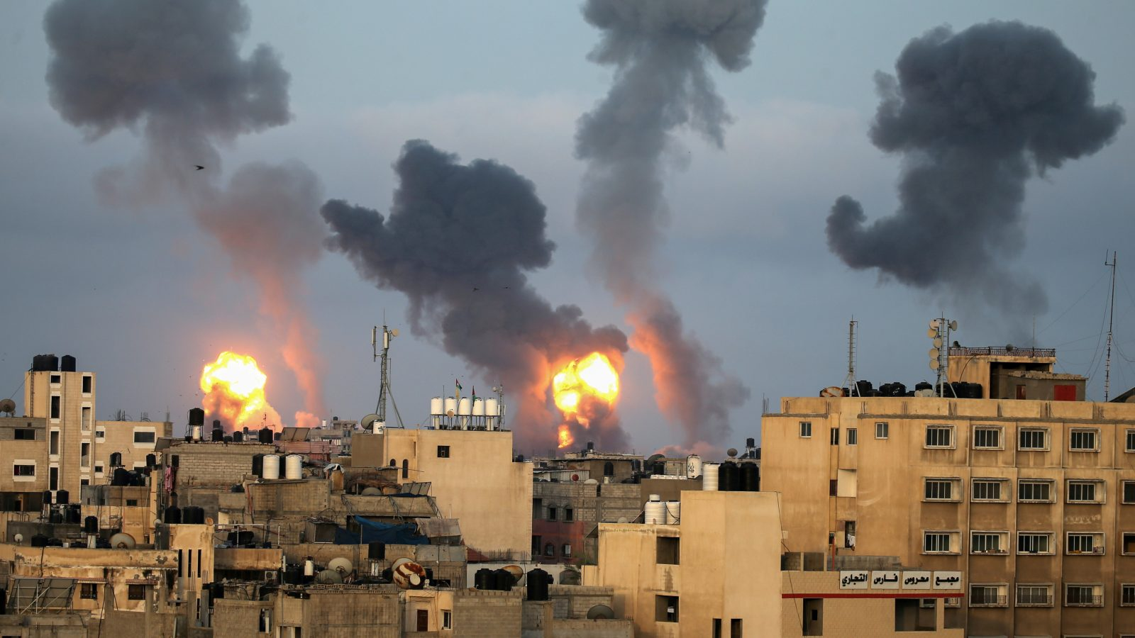 Fires and dark smoke rise over buildings in Gaza