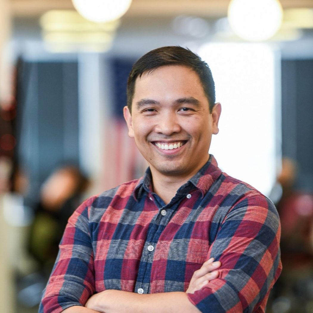 Headshot of Gerard Lumban wearing a red-blue plaid shirt