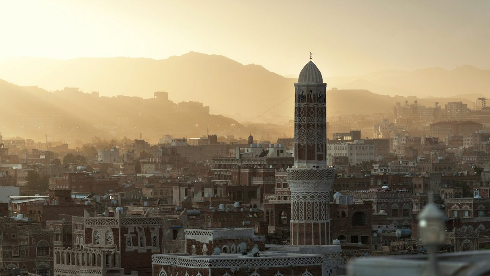 A cityscape during golden hour in Yemen