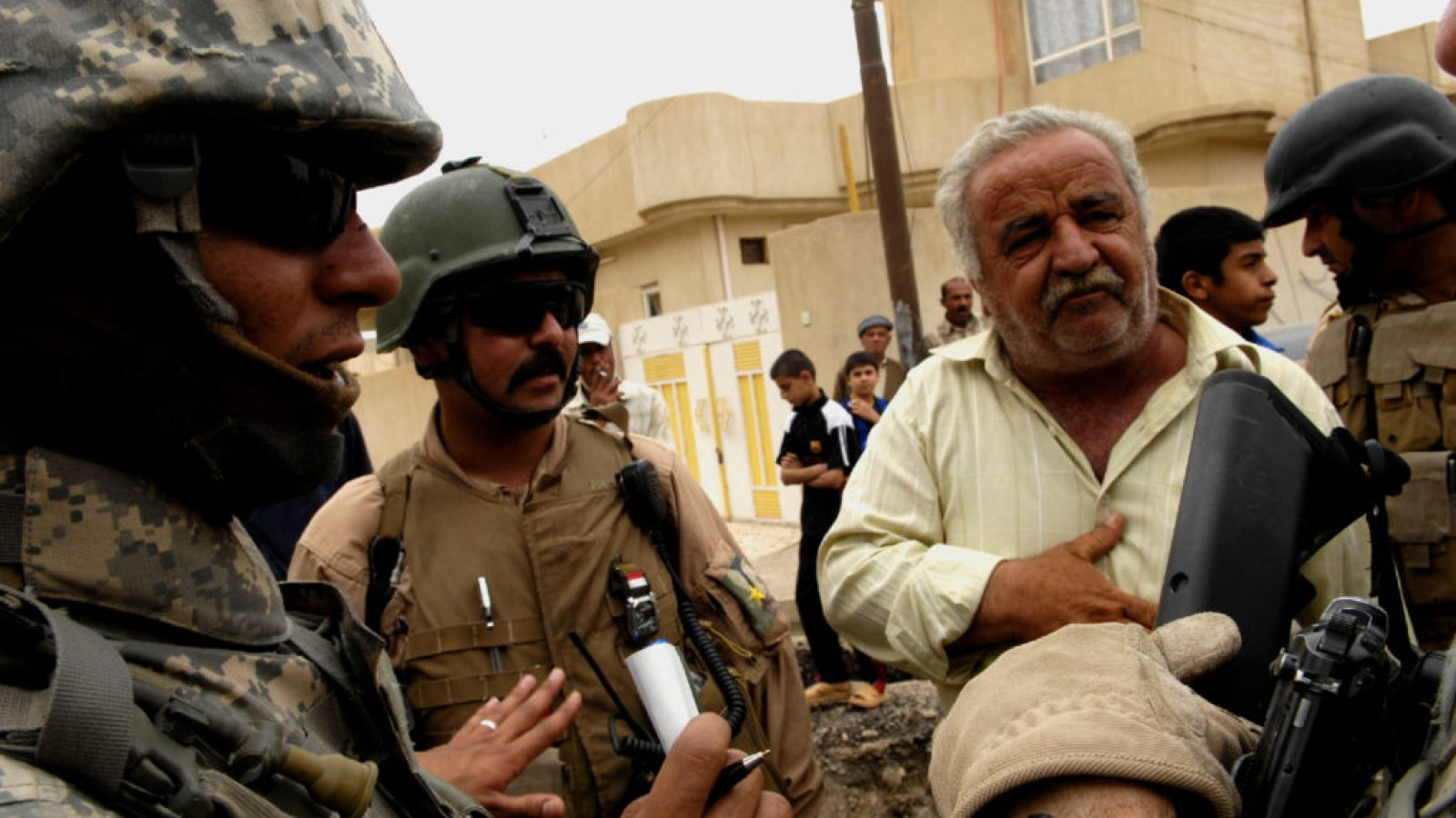 An interpreter talks with US soldiers