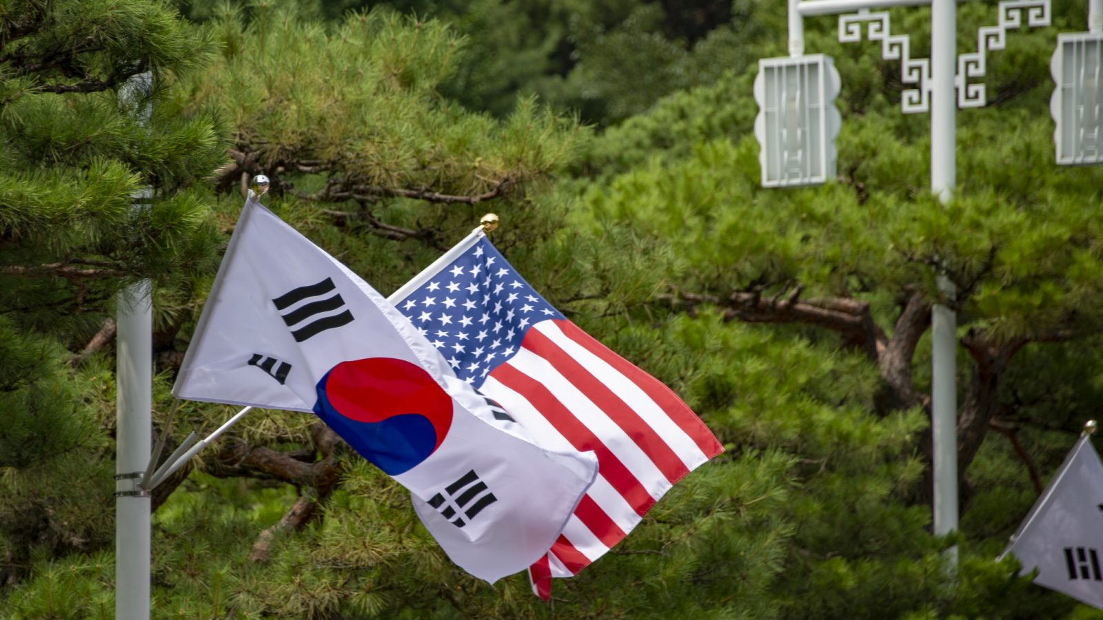 The flags of the U.S. and South Korea hang side by side