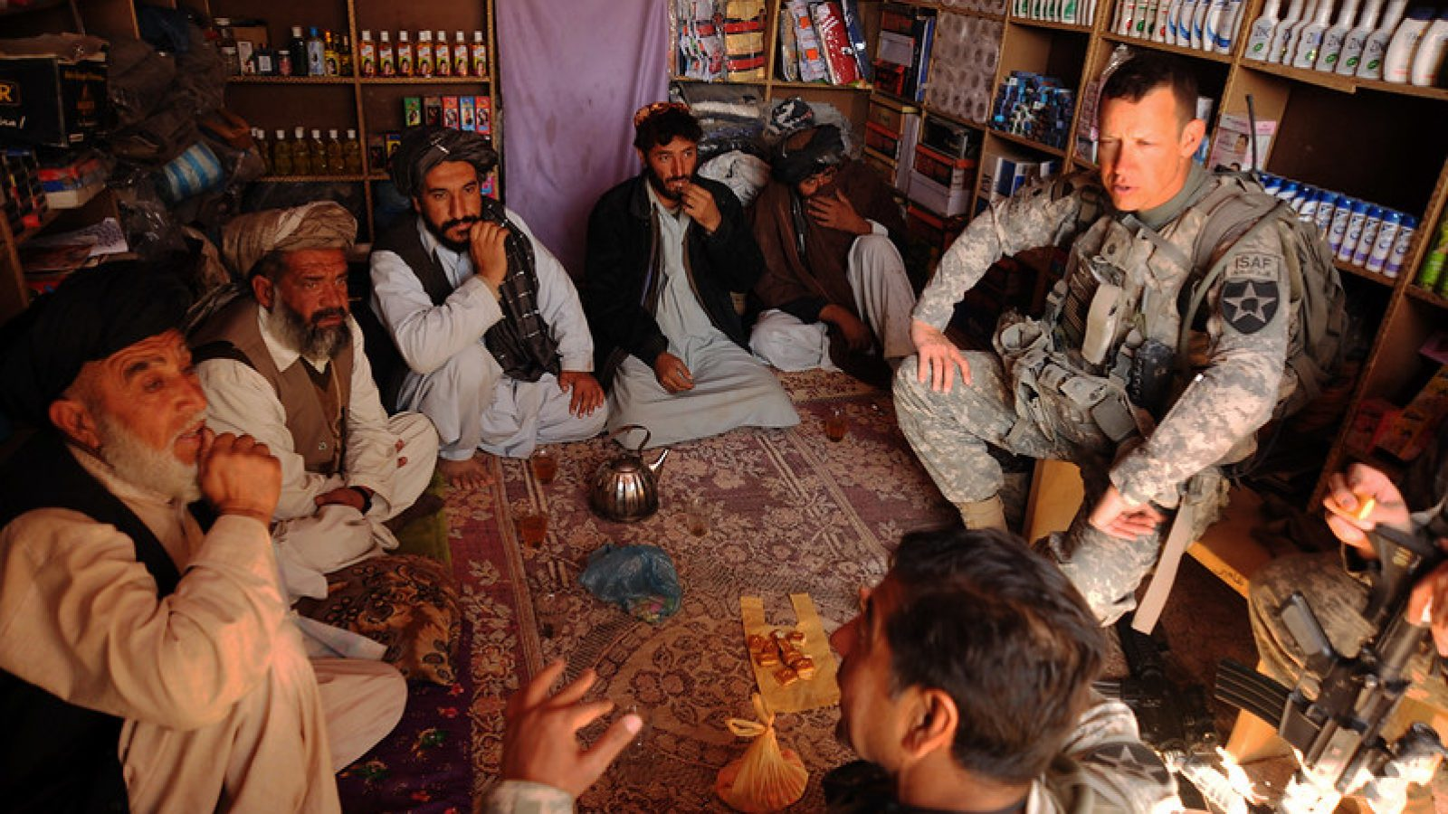 U.S. Army Lt. Col. Burton Shields, commander of 4th Battalion, 23rd Infantry Regiment, and his translator, hold a key leader engagement in Karezgay, Afghanistan