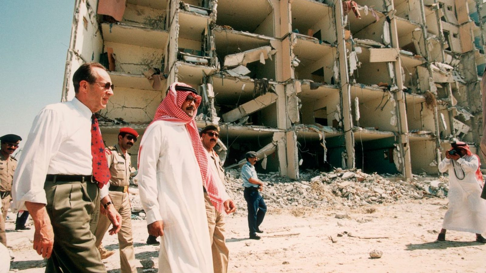 Then-Secretary of Defense William Perry tours the wreckage of Khobar Towers in Dhahran, Saudi Arabia