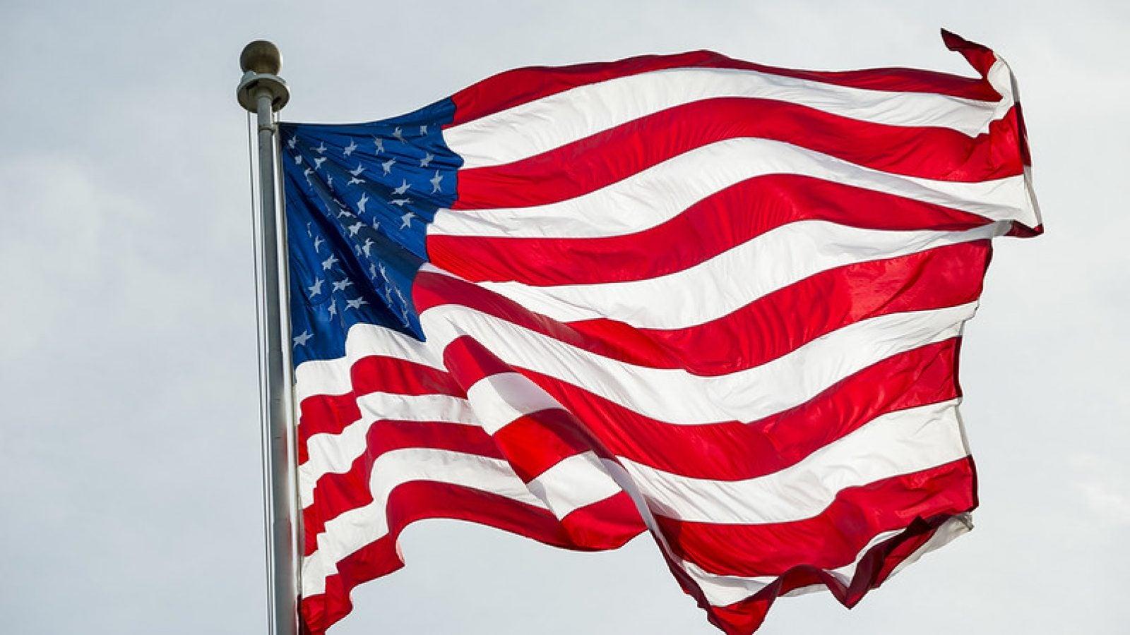 A U.S. flag flies in the wind