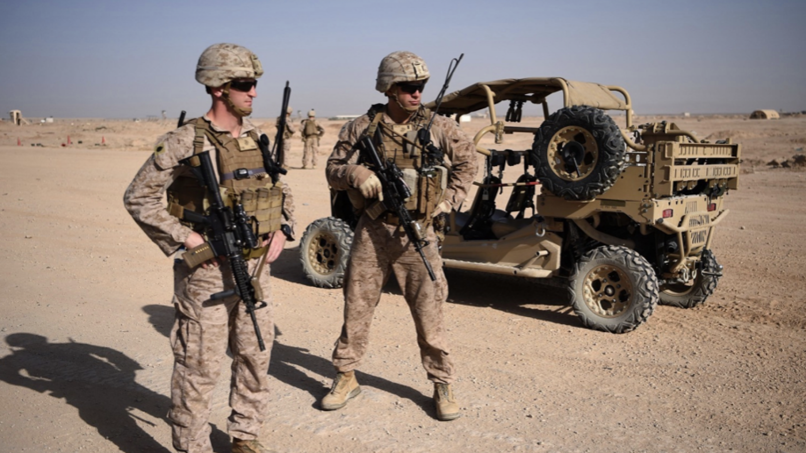 U.S. Marines keep watch as unseen Afghan National Army soldiers participate in an improvised explosive device training exercise in Lashkar Gah in the Afghan province of Helmand on Aug. 28, 2017.