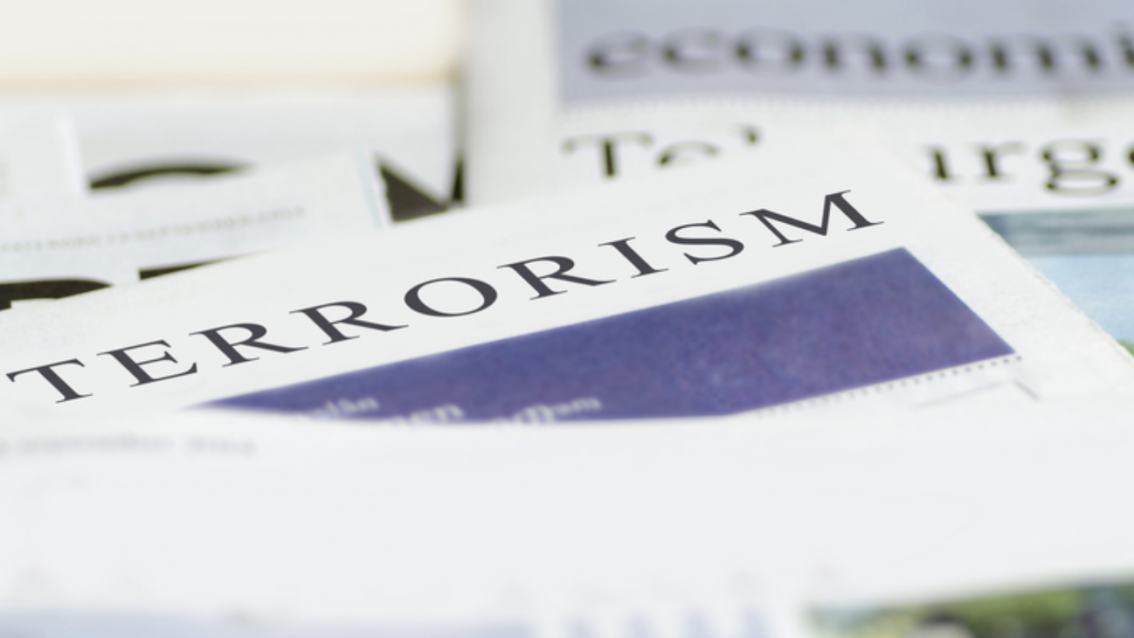 Photo of a newspaper with the headline 'Terrorism' in all caps.